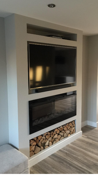 50 inch inset wall hung electric fire with TV above