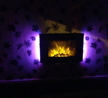 truflame wall mounted electric fire with pebbles and LEDs