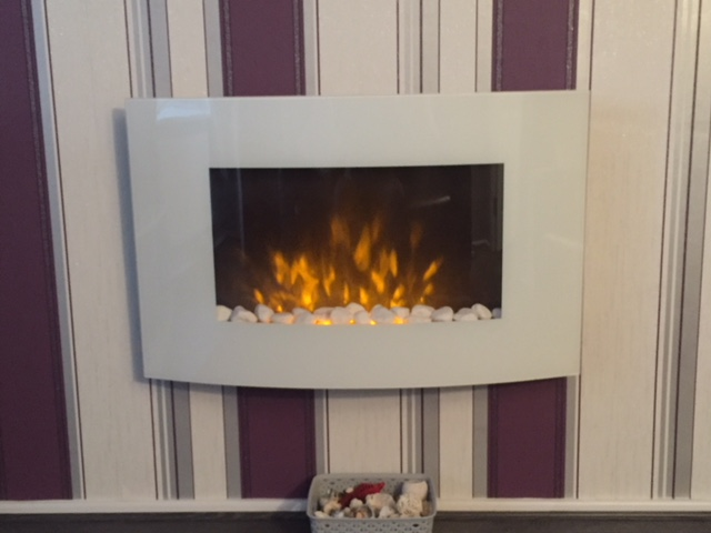 Wall mounted electric fire hung on wall