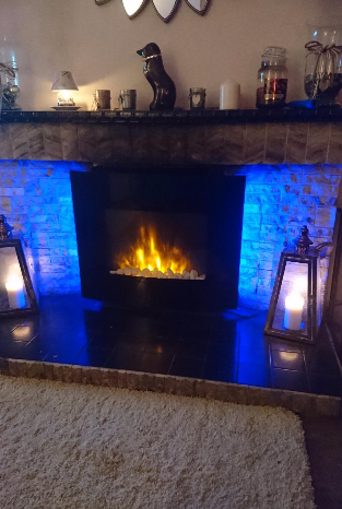 small wall mounted electric fire with pebbles and LEDs