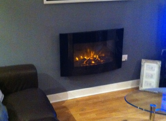 TruFlame Wall Mounted Arched Glass Electric Fire with Log Effect fitted to the wall
