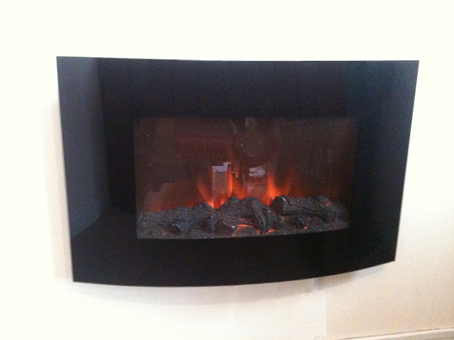TruFlame Wall Mounted Arched Glass Electric Fire with Log Effect on wall