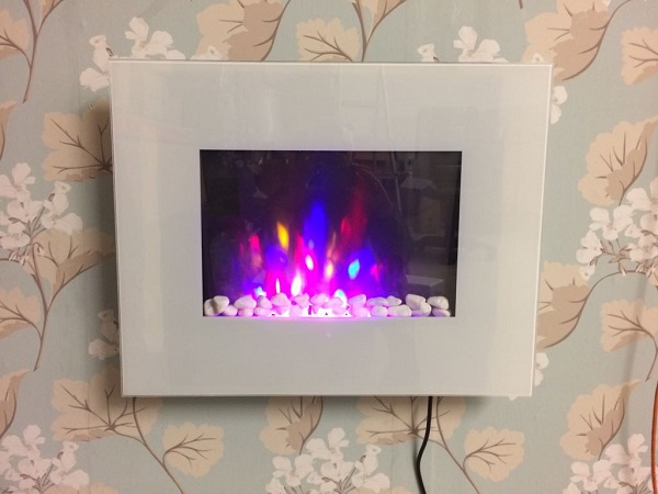TruFlame LED Side Lit (7 colours) Wall Mounted Flat White Glass Electric Fire with Log and Pebble Effect showing truflame effect colour 7