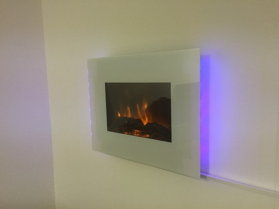 TruFlame LED Side Lit (7 colours) Wall Mounted Flat White Glass Electric Fire with Log and Pebble Effect hung on wall with logs