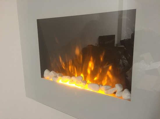 TruFlame LED Side Lit (7 colours) Wall Mounted Flat White Glass Electric Fire with Log and Pebble Effect showing truflame effect