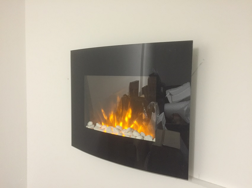 TruFlame LED Side Lit (7 colours) Wall Mounted Arched Glass Electric Fire with Pebble Effect on wall