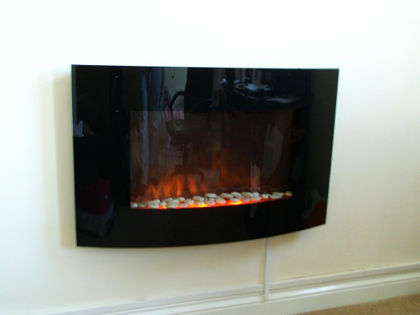 TruFlame Wall Mounted Arched Glass Electric Fire with Pebble Effect (88cm wide) fitted on the wall
