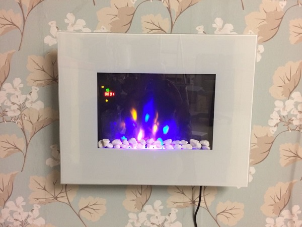 TruFlame LED Side Lit (7 colours) Wall Mounted Flat White Glass Electric Fire with Log and Pebble Effect showing truflame effect colour 2