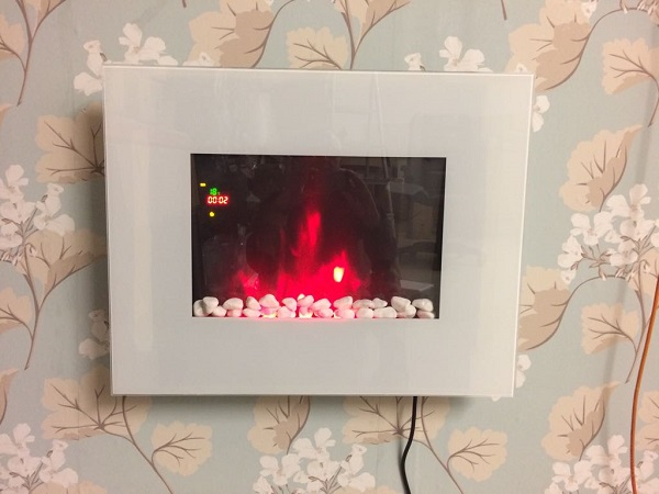 TruFlame LED Side Lit (7 colours) Wall Mounted Flat White Glass Electric Fire with Log and Pebble Effect showing truflame effect colour 4