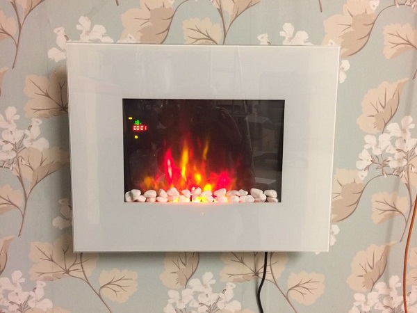 TruFlame LED Side Lit (7 colours) Wall Mounted Flat White Glass Electric Fire with Log and Pebble Effect showing truflame effect colour 6