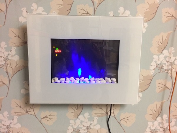 TruFlame LED Side Lit (7 colours) Wall Mounted Flat White Glass Electric Fire with Log and Pebble Effect showing truflame effect colour 5