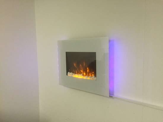 TruFlame LED Side Lit (7 colours) Wall Mounted Flat White Glass Electric Fire with Log and Pebble Effect hung on wall