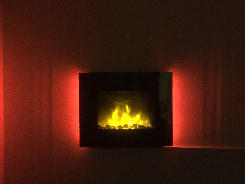 TruFlame LED Side Lit (7 colours) Wall Mounted Arched Glass Electric Fire with Pebble Effect front view red leds
